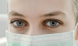 Up close of a woman in a surgical mask